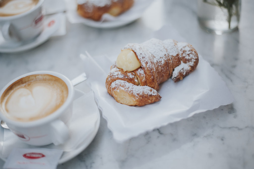 Italian croissant and cappuccino